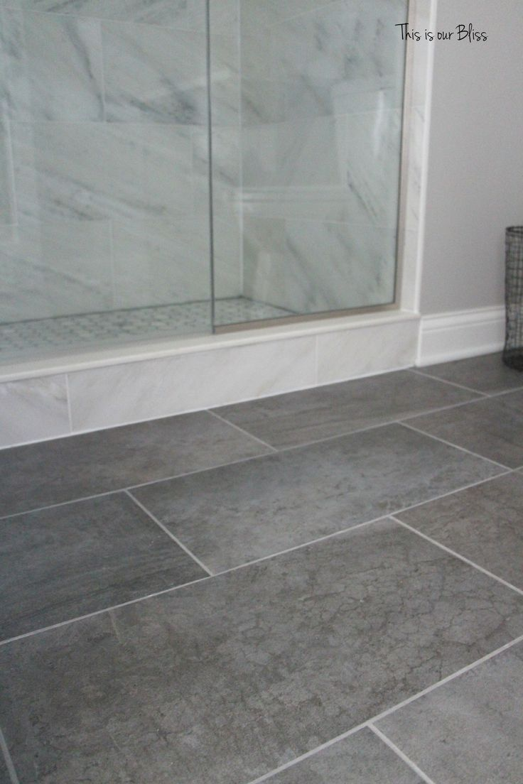 Soothing gray tile set in a herringbone pattern give this small ...