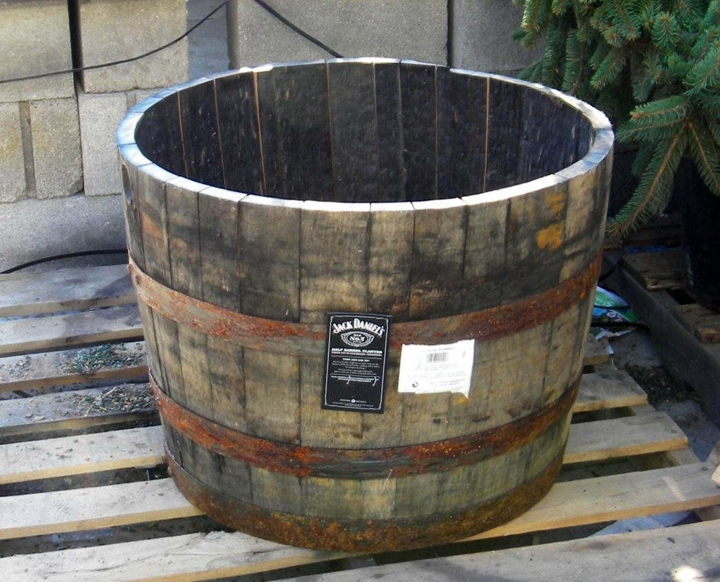 An Old Jack Daniel S Whiskey Barrel Makes A Great Planter Whiskey Barrel Planter Barrel Planter Whiskey Barrel