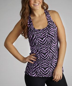 This figure-flattering tank gets any routine off to a great start. Featuring a playful keyhole peeping from the back and hint of spandex stretch, this piece is workout perfection.