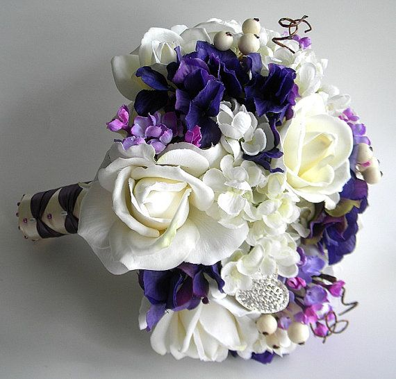 Bridesmaids will have more purples, hint of pink orchids and silver beads
