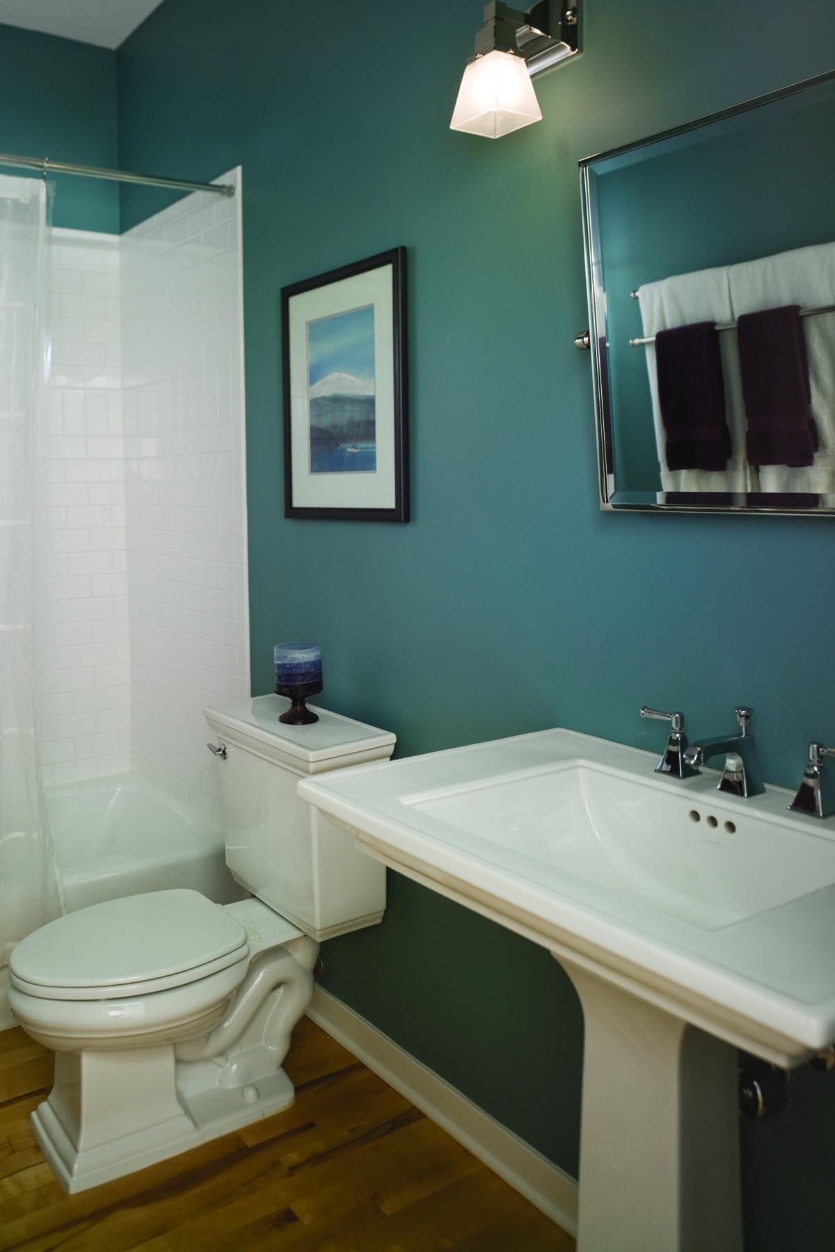 Dark wood floors, pedestal sink, and teal walls! Love the ...