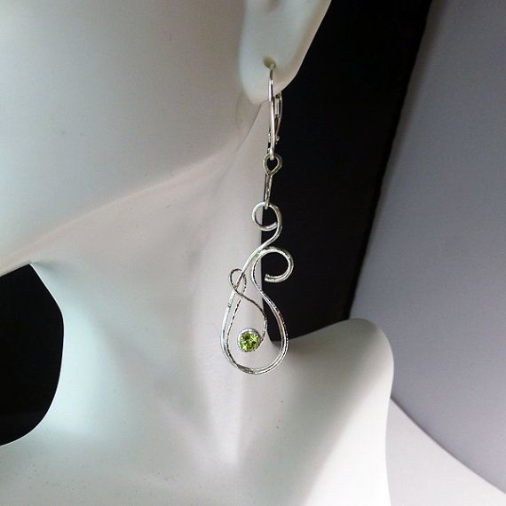 Check out this item in my Etsy shop https://www.etsy.com/listing/225625628/35mm-apple-green-peridots-in-handcrafted