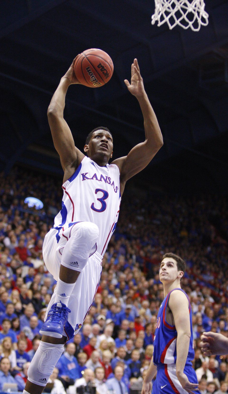 Kansas guard Andrew White elevates to the bucket for a
