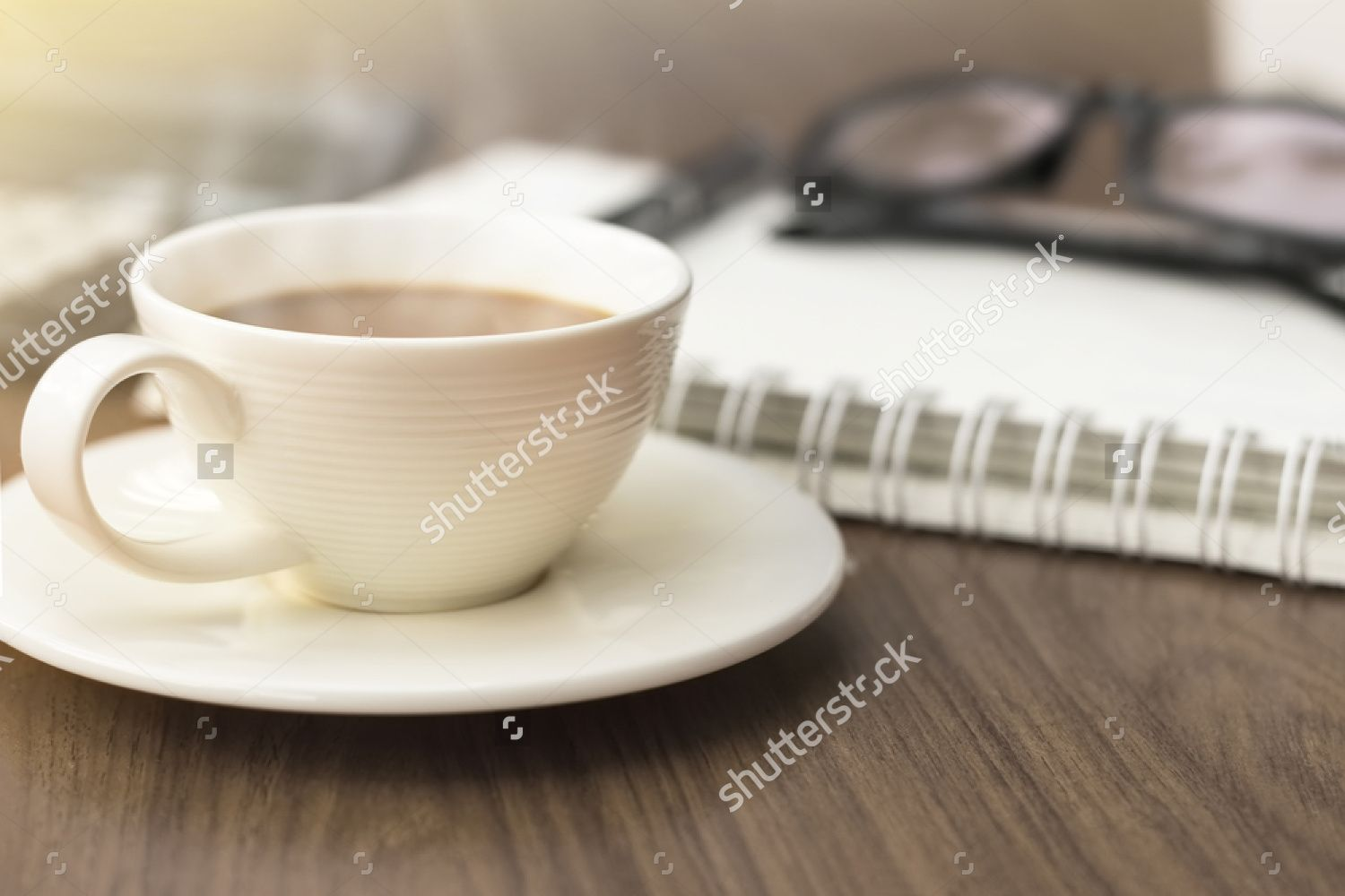 office coffee cups. A Coffee Cup And Blank Notebook, On The Office Desk Background In Cups C
