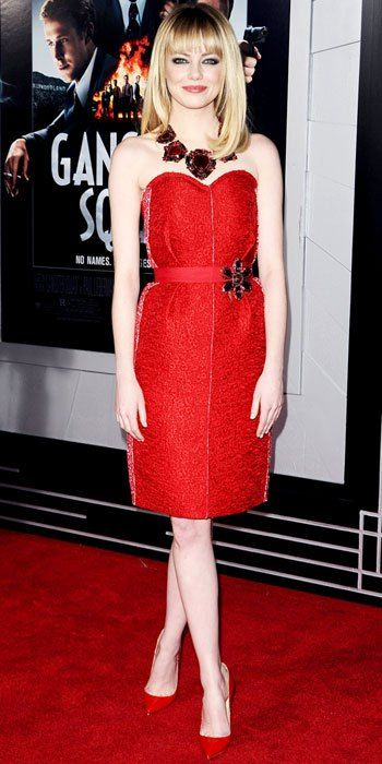 Emma Stone in a red strapless dress by Lanvin with red pointy toe pumps by Christian Louboutin.