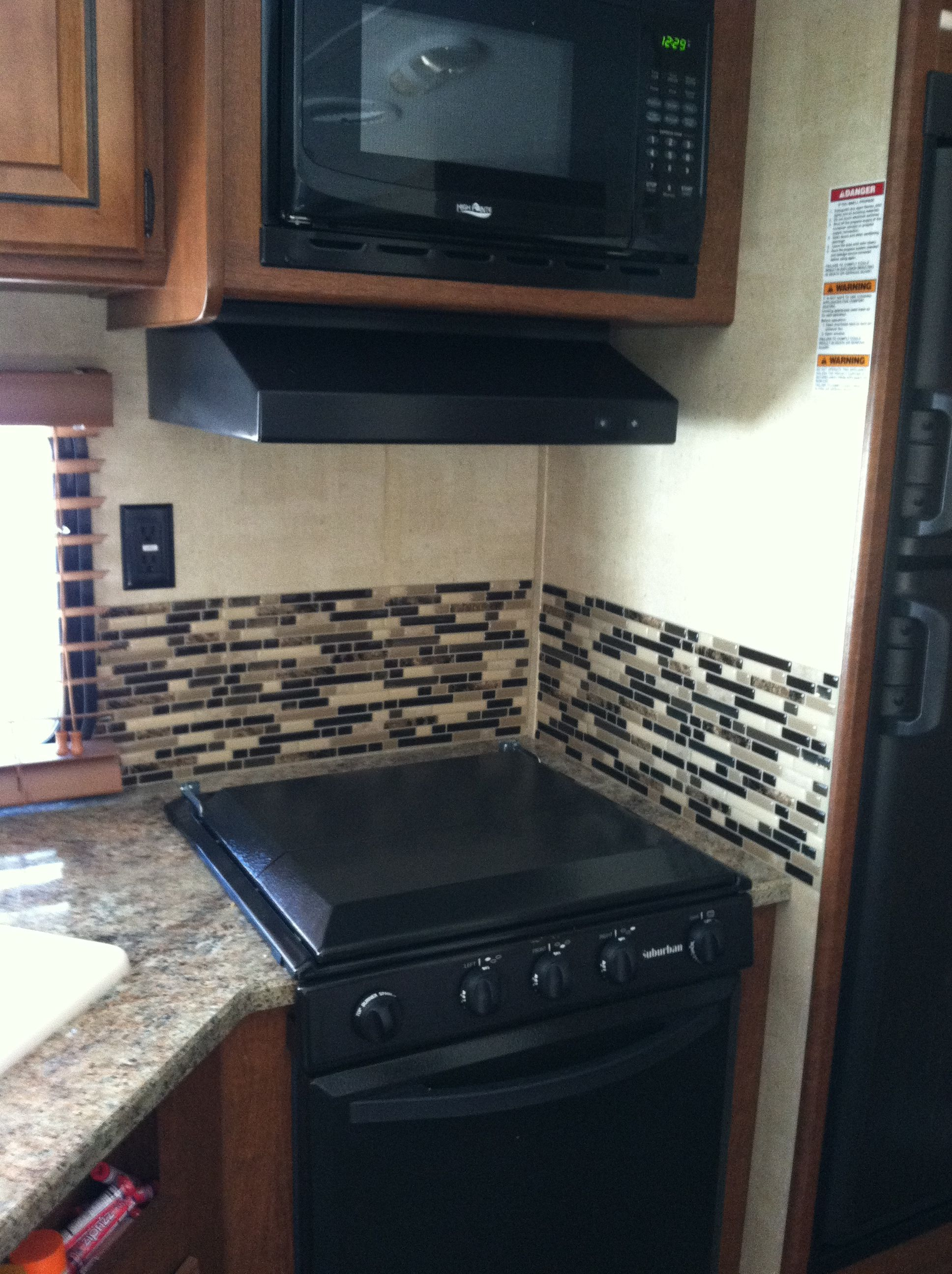 Replaced The Hideous Wallpaper Border With Peel And Stick Smart Tiles From Home Depot Love The Lo Kitchen Backsplash Designs Remodeled Campers Rv Kitchen