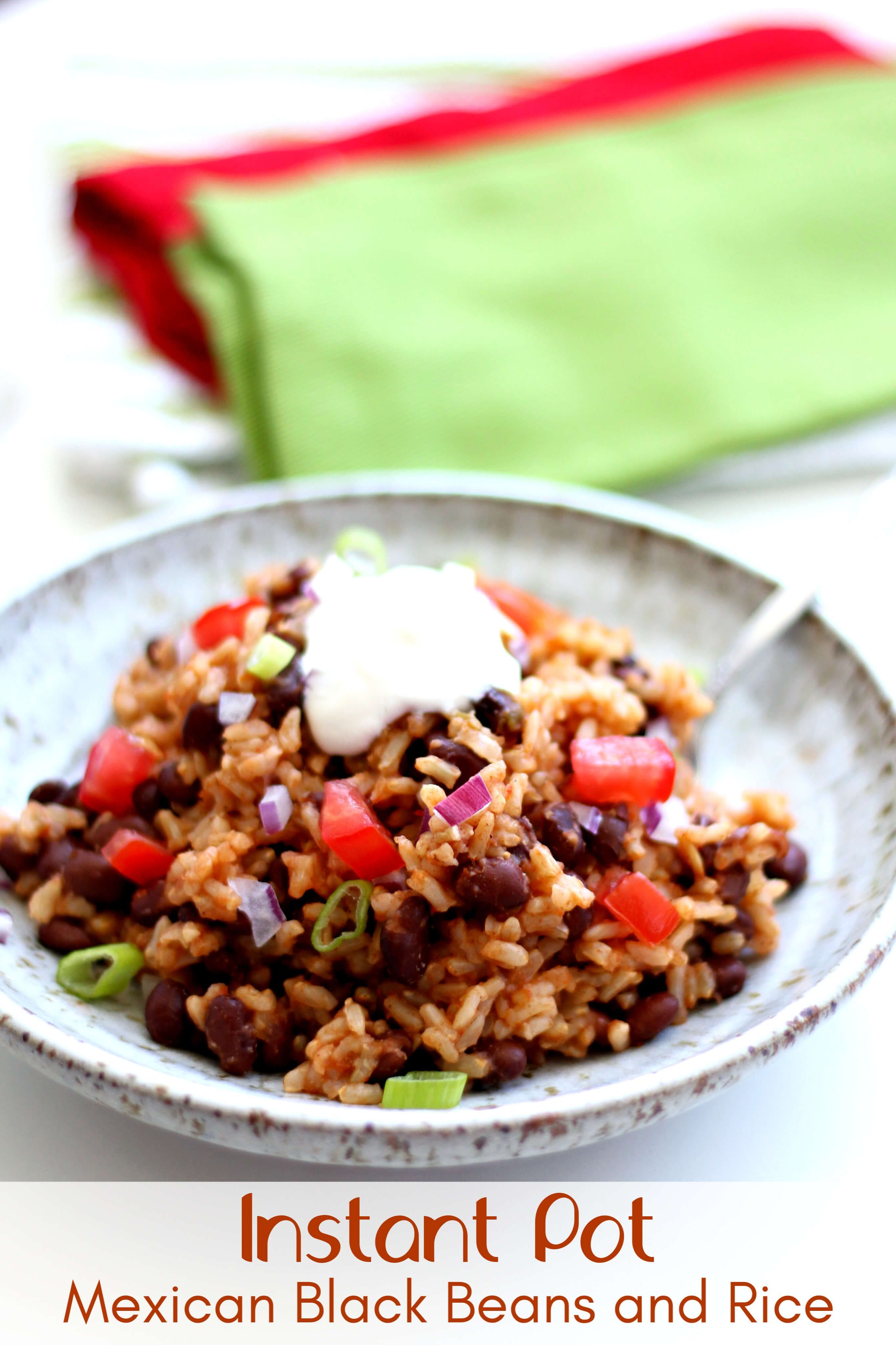 Instant Pot Mexican Black Beans and Rice–the easiest and tastiest rice ever! Brown rice is cooked in flavorful salsa with garlic salt, a bay leaf and cumin. Canned black beans make this recipe very convenient. And my favorite part is a squeeze of lime juice and a dollop of sour cream on top. Make this as a meal or as a side dish. 153896512255247767
