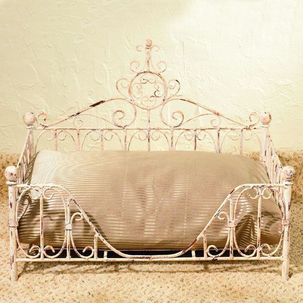 Add a bit of Parisian flair to your home while giving your cat or small dog a cozy place to sleep with our delightful pet bed.  The rustic iron frame will look splendid holding the pillow that you sup...