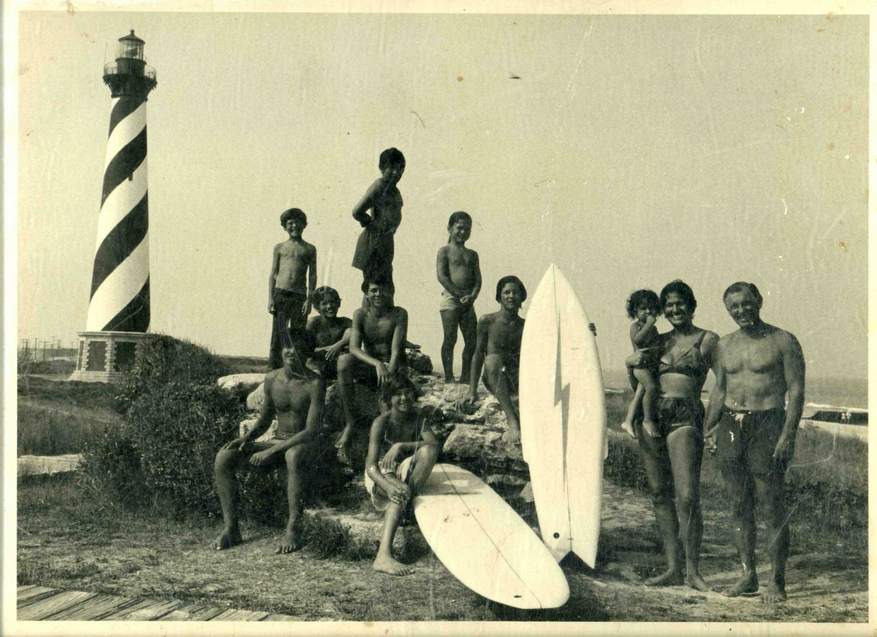 Vintage Photo Of Surfers In Front Of Cape Hatteras Lighthouse On The Outer Banks Of North Carolina Vintage Surf Surfing Cape Hatteras Lighthouse
