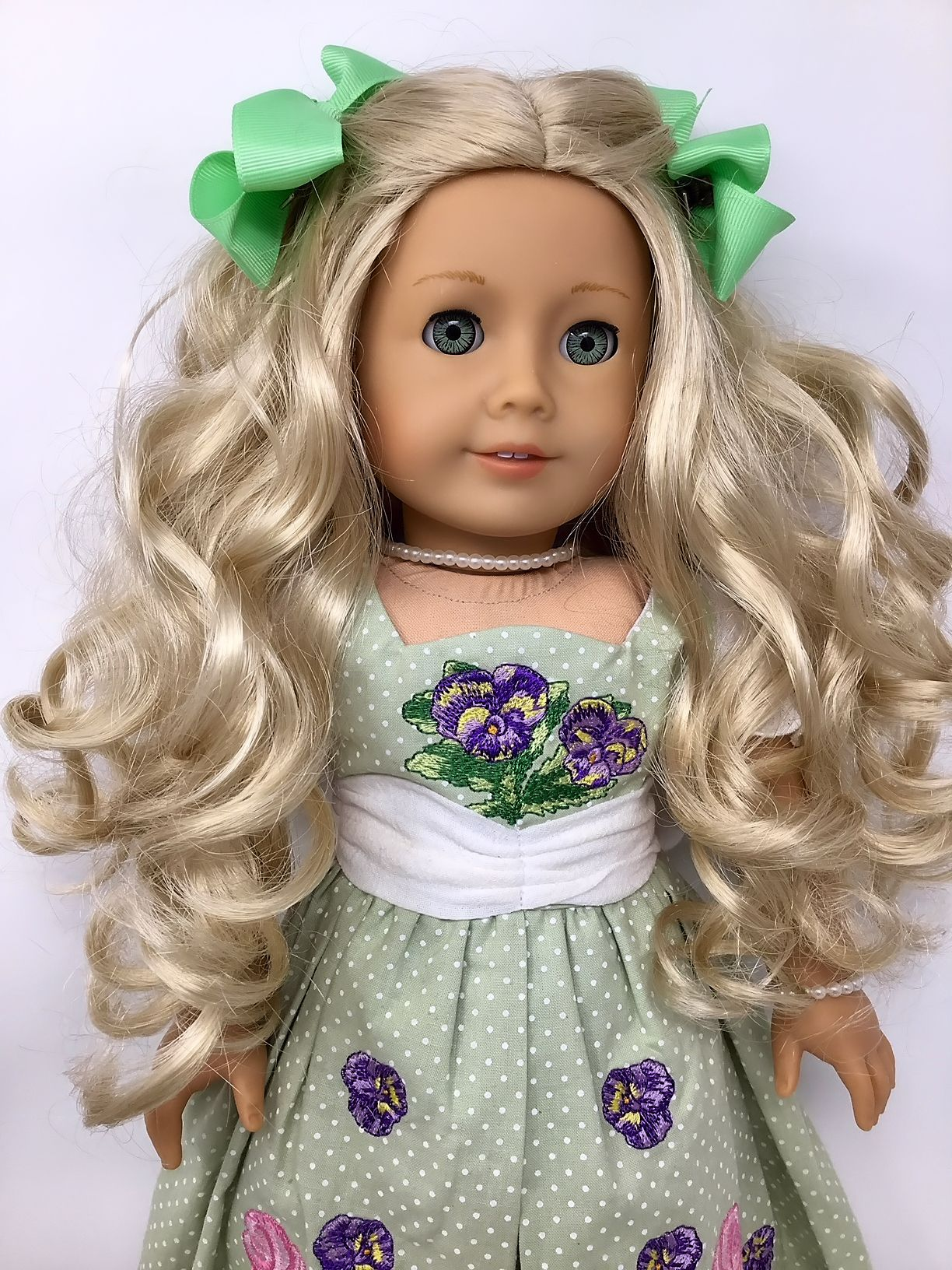 American girl doll caroline with long curly blonde hair