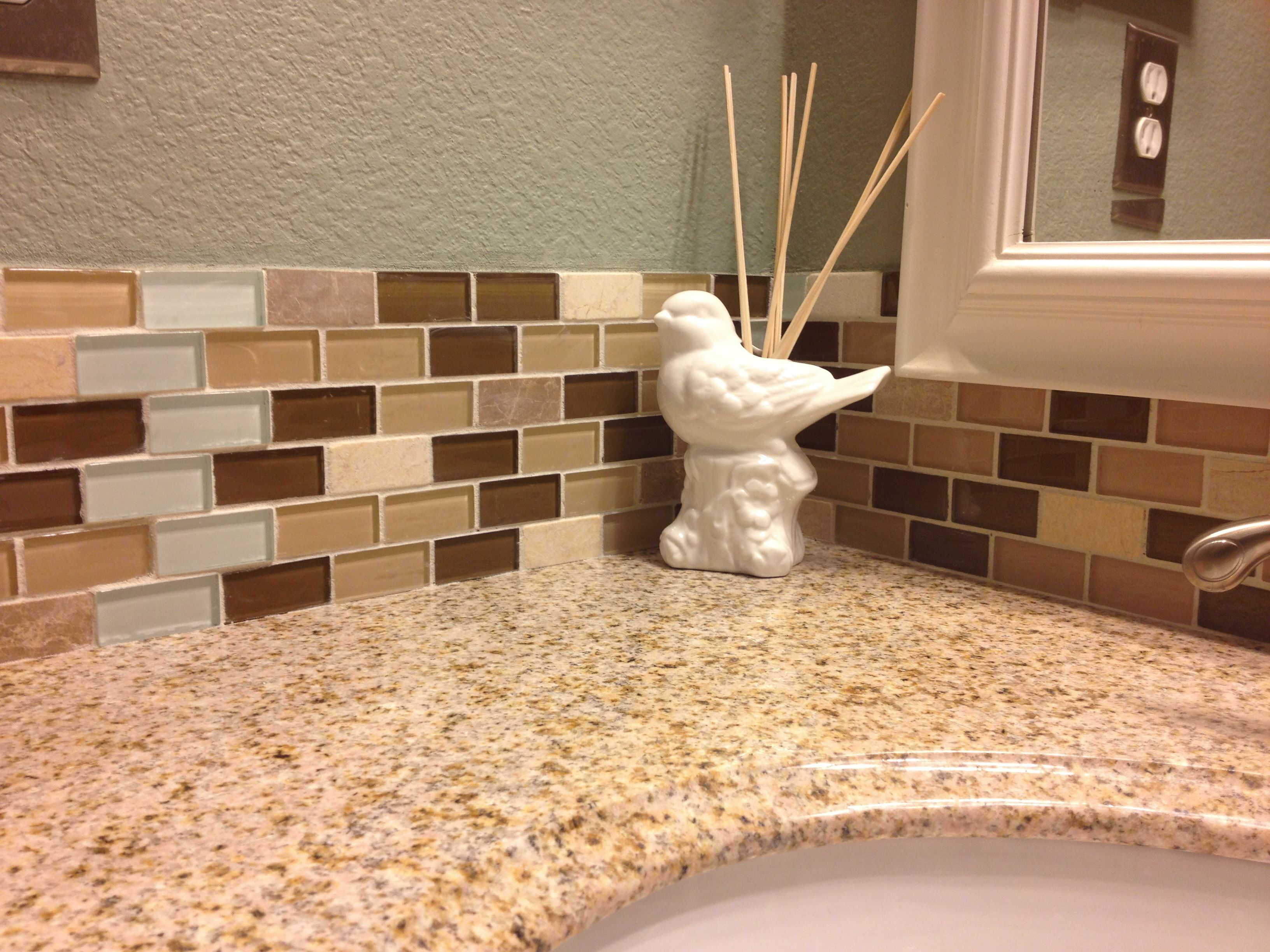 Bathroom tile backsplash, slightly wraps the mirror | Basement ...