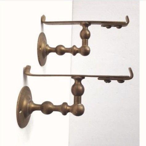 These turn of the century ornate brass bathroom shelf brackets are ...