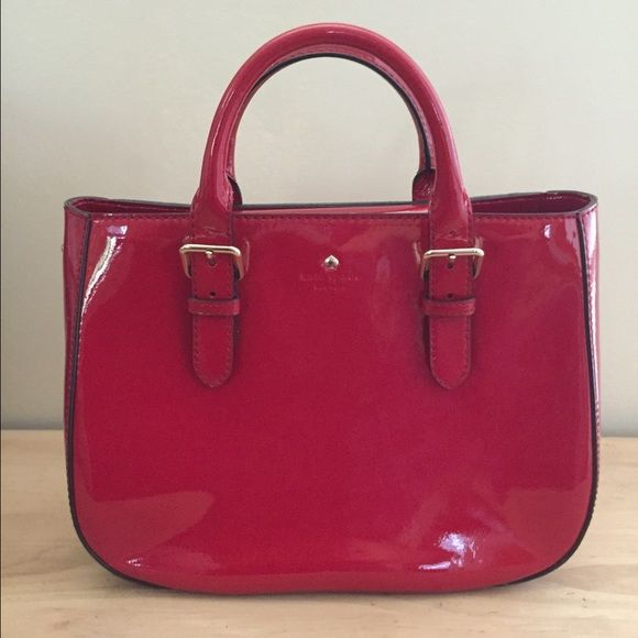 Kate Spade red patent leather purse Like New Carlisle Street Sylvie Patent Leather Satchel Bag - Like New condition. Barely used and always stored in dust bag. Optional shoulder strap comes with. Inside is red with white polka dots. Selling only, no trades. kate spade Bags
