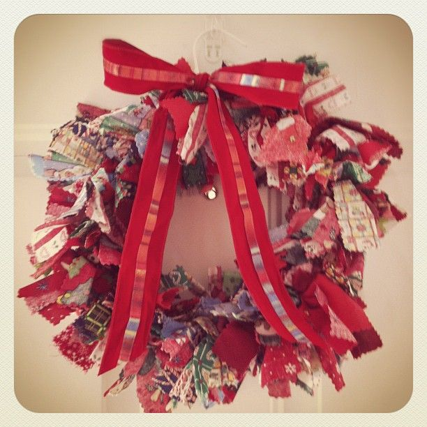My daughter, Jolene, made this for me at school in 1st grade.  They just tied strips o fabric to a wire hanger.  So beautiful and easy, one of my favorite decorations!