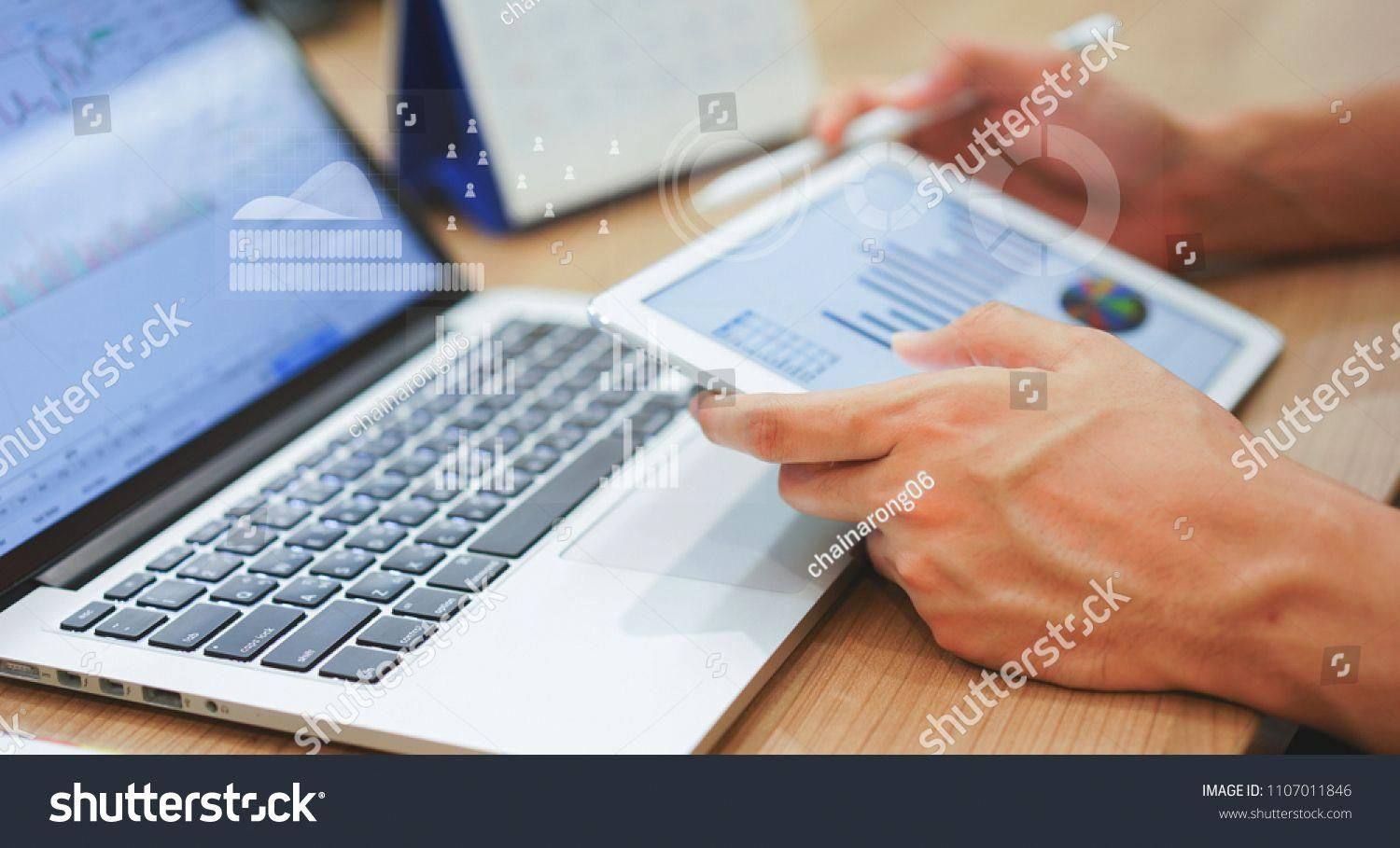 Close Up Business Man Hand Hold Tablet For Thinking About Stock