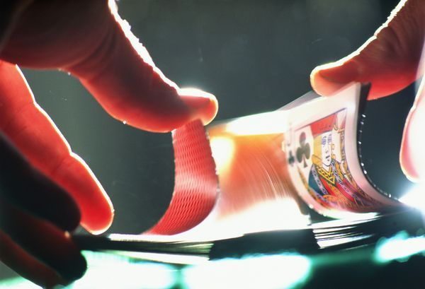 Hands shuffling cards, close-up