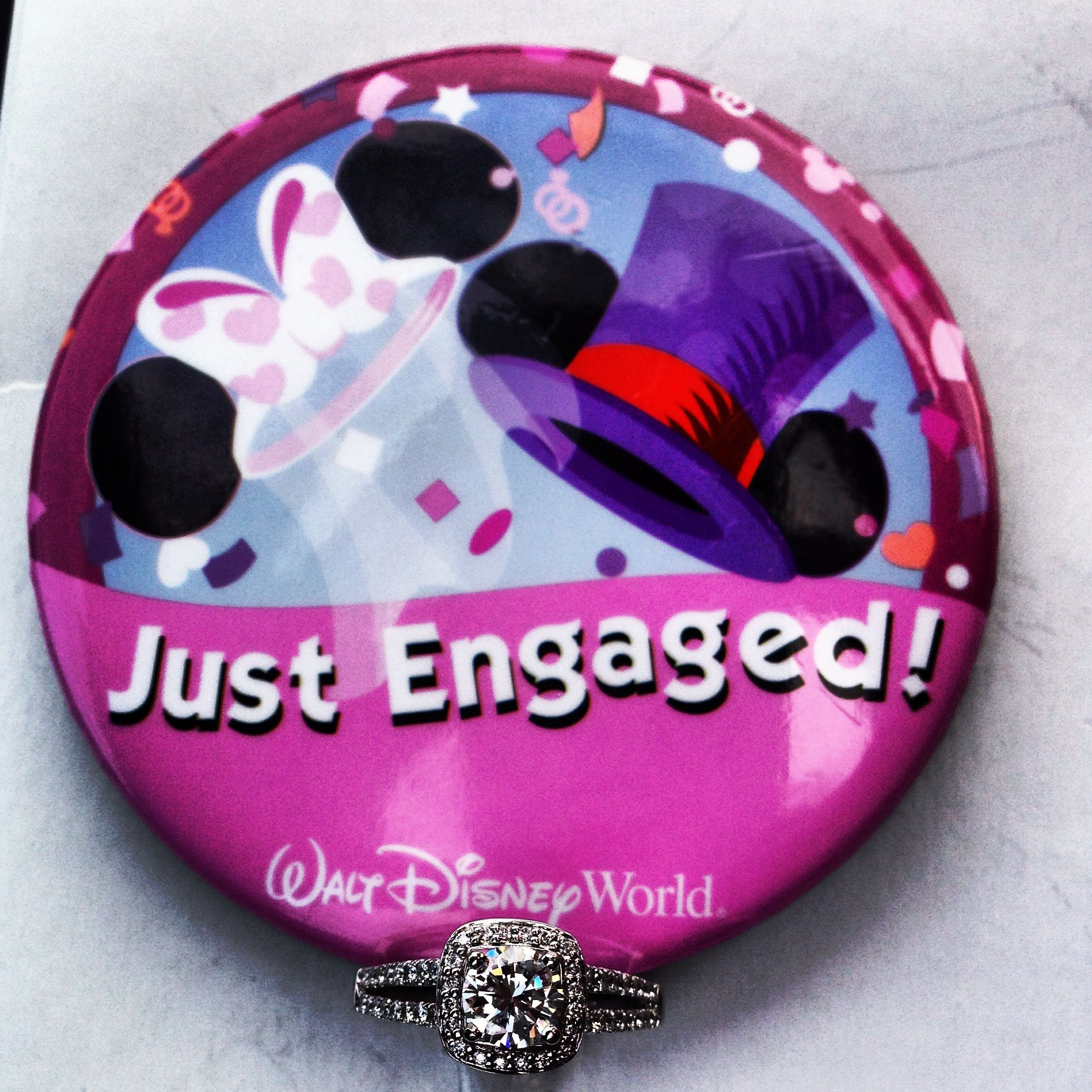 Picture for our engagement announcement...my ring + pin from Disney ...