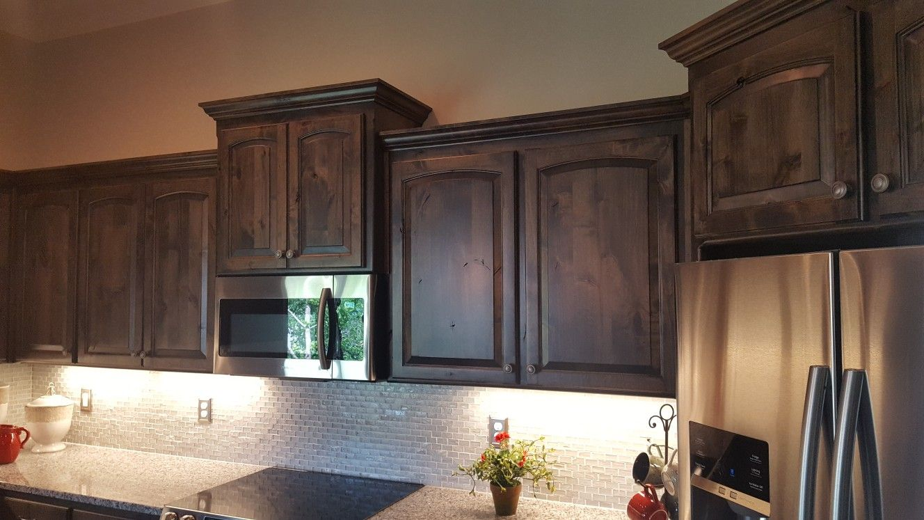 Knotty Alder Cabinets With An Ebony Stain Oil Rubbed Bronze Knobs