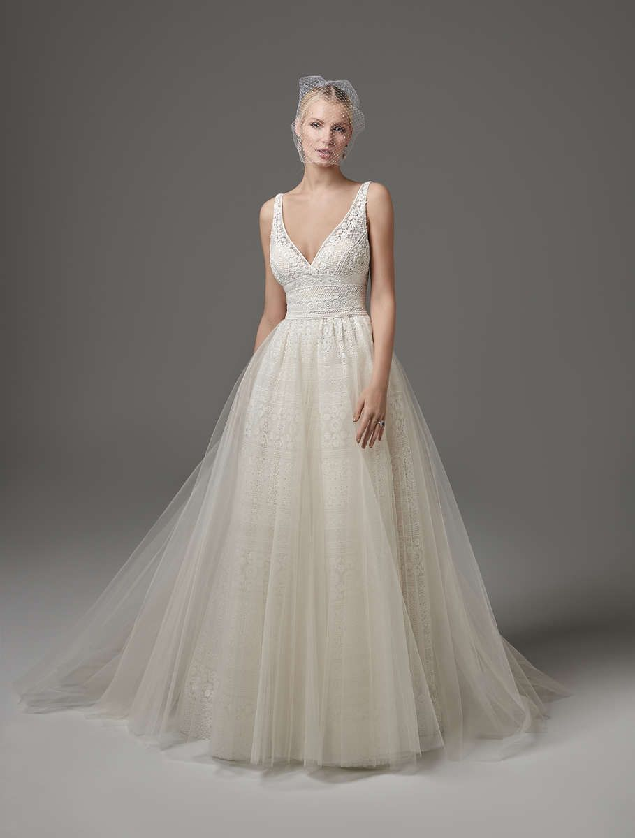 Chic boho wedding dress features sheer pockets and patterns of