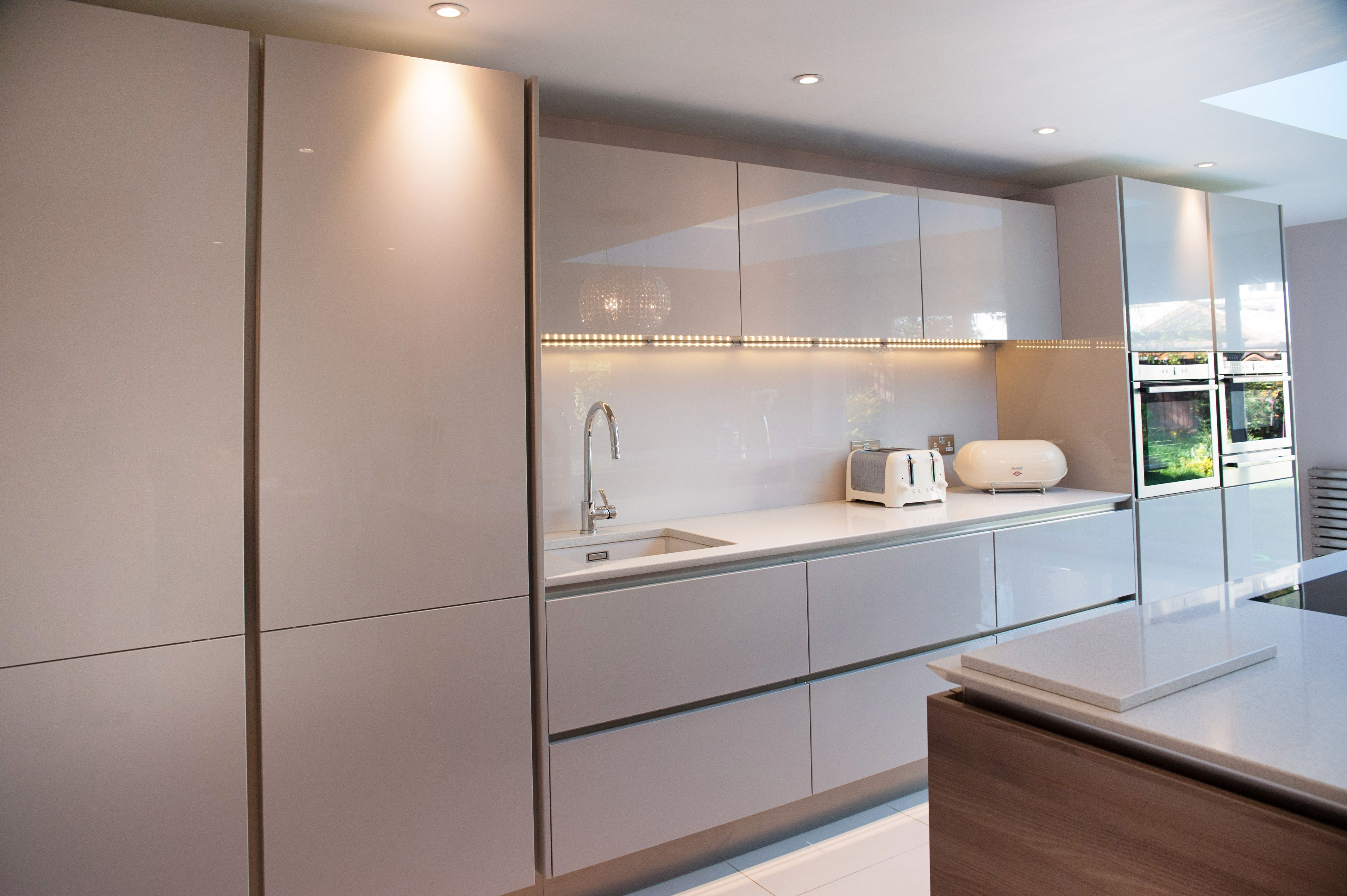 handleless white and cashmere high gloss doors with posite