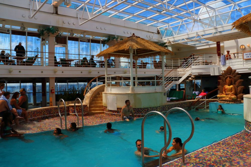 Indoor covered lotus swimming pool on coral princess cruise ship coral princess pinterest for River cruise ships with swimming pool