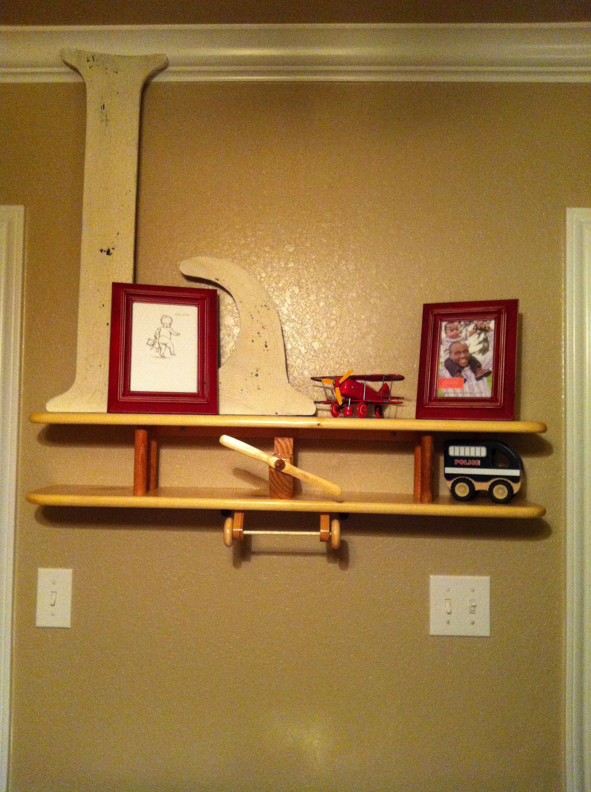 This airplane shelf, which is COOL, was a gift for Landon at one of his baby showers! The L was a find at one of my favorite spots, Canton.