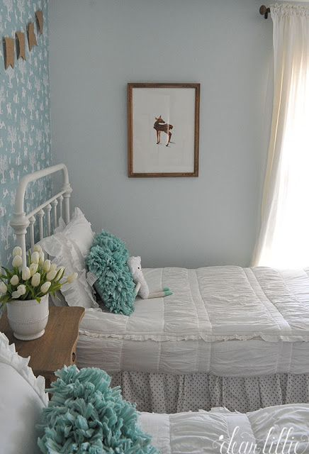 The blue and white mixed with wood tones helps give warmth to this sweet little vintage style girls room with the iron beds Accessories like the wood nightstand and ruffl...