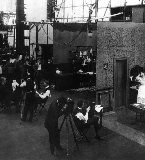 Edison Studios, circa 1907–1914 (Bronx, NY) | A silent film studio in action - relatively simple, three-sided sets could be built side by side to make maximum use of the space, with two or more films shooting simultaneously.