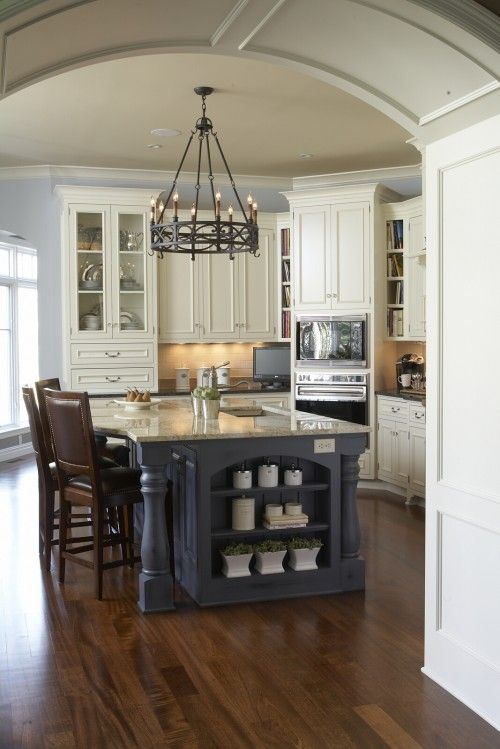 Color contrast of cabinets, island, and floor