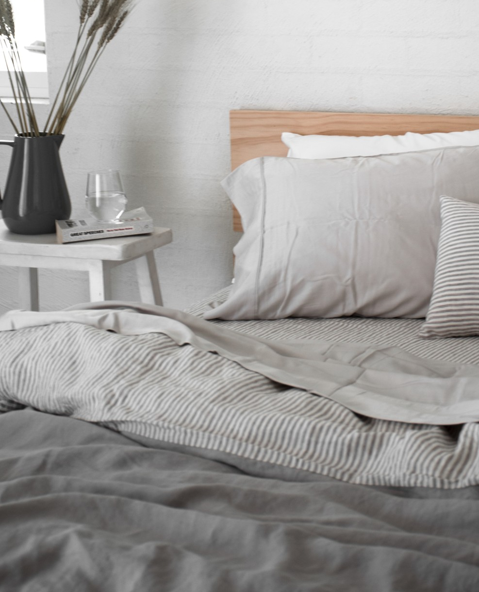 A Soft Grey French Linen Quilt Cover Paired With A Soft Grey Striped Sheet Set With A Hint Of White Minima Minimalist Bed Bed Linens Luxury Striped Bed Sheets
