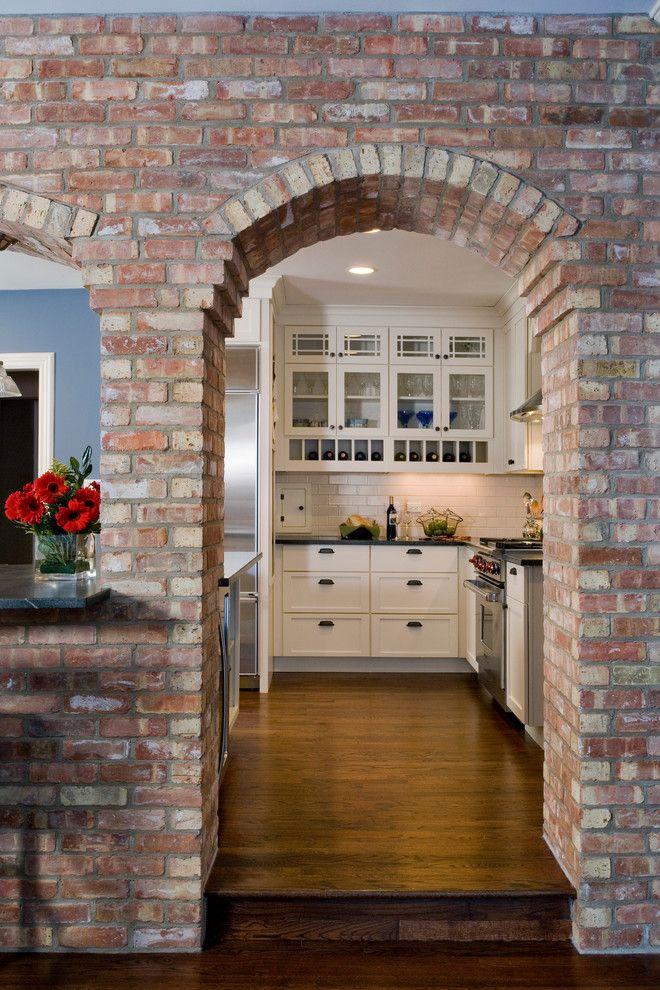 interior brick wall Kitchen Traditional with beige subway tile backsplash  beige