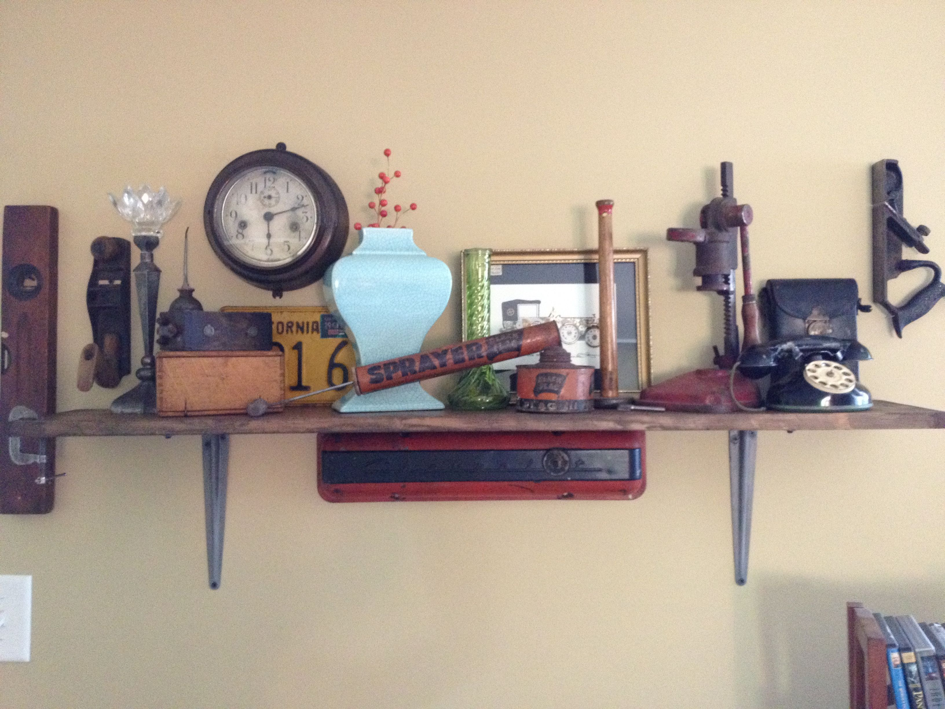 Shelf made with vintage car parts; decorated with random tools ...