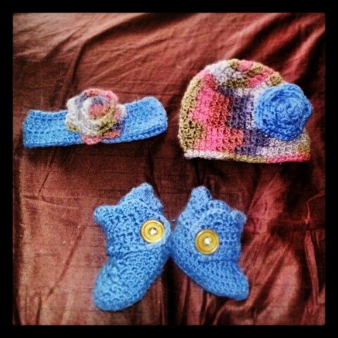 Crocheted infant set. Booties, hat, and headband