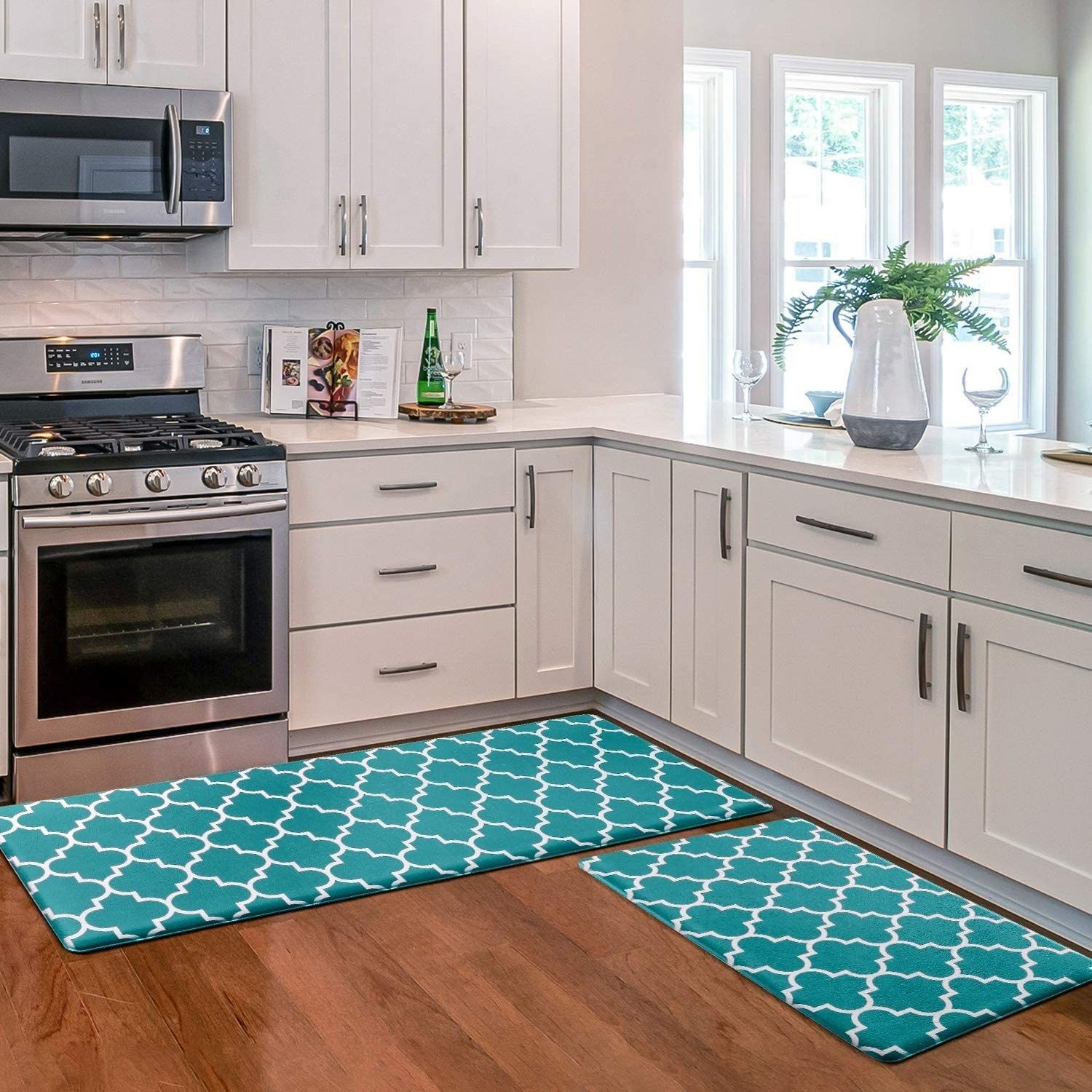 A set of anti-fatigue mats folks rave over because they're basically the comfiest ones out there, and they're wicked easy to clean: stuff wipes right off!