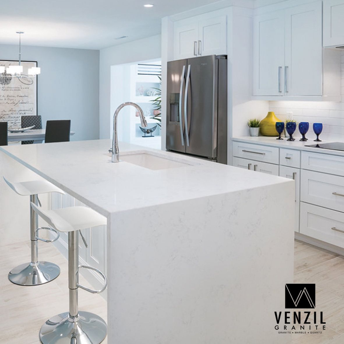 Carrara Thassos Quartz Modern Elegant Waterfall Kitchen Island And Counter Tops Made By Venzil Granite Waterfall Island Kitchen Kitchen Marble Countertops