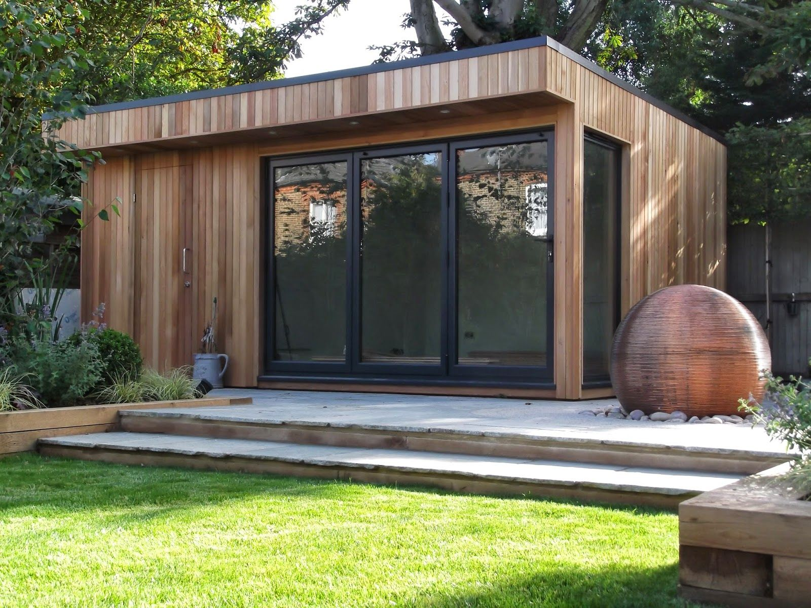 Cedar summerhouse in barnet with grey bi fold doors for Garden office design