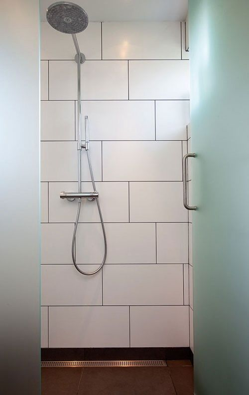 Large White Rectangular Tile With Black Grout White Bathroom Tiles Retro Bathrooms White Tile Shower