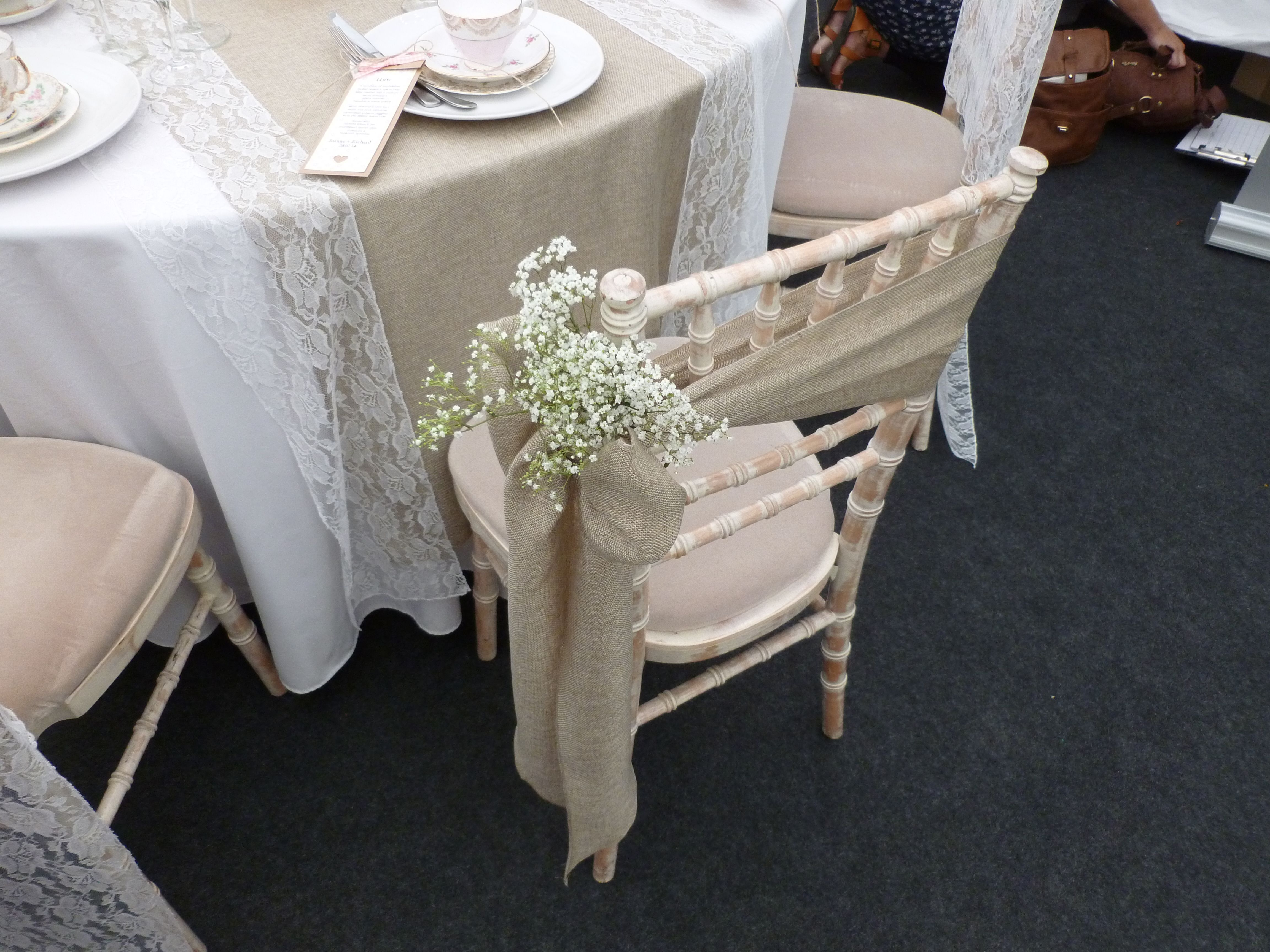 Burlap Sash With Babies Breath Still A Popular Choice Dressed By Simply Bows And Chair Covers Chaircovers W Chair Covers Wedding Chair Covers Wedding Chairs