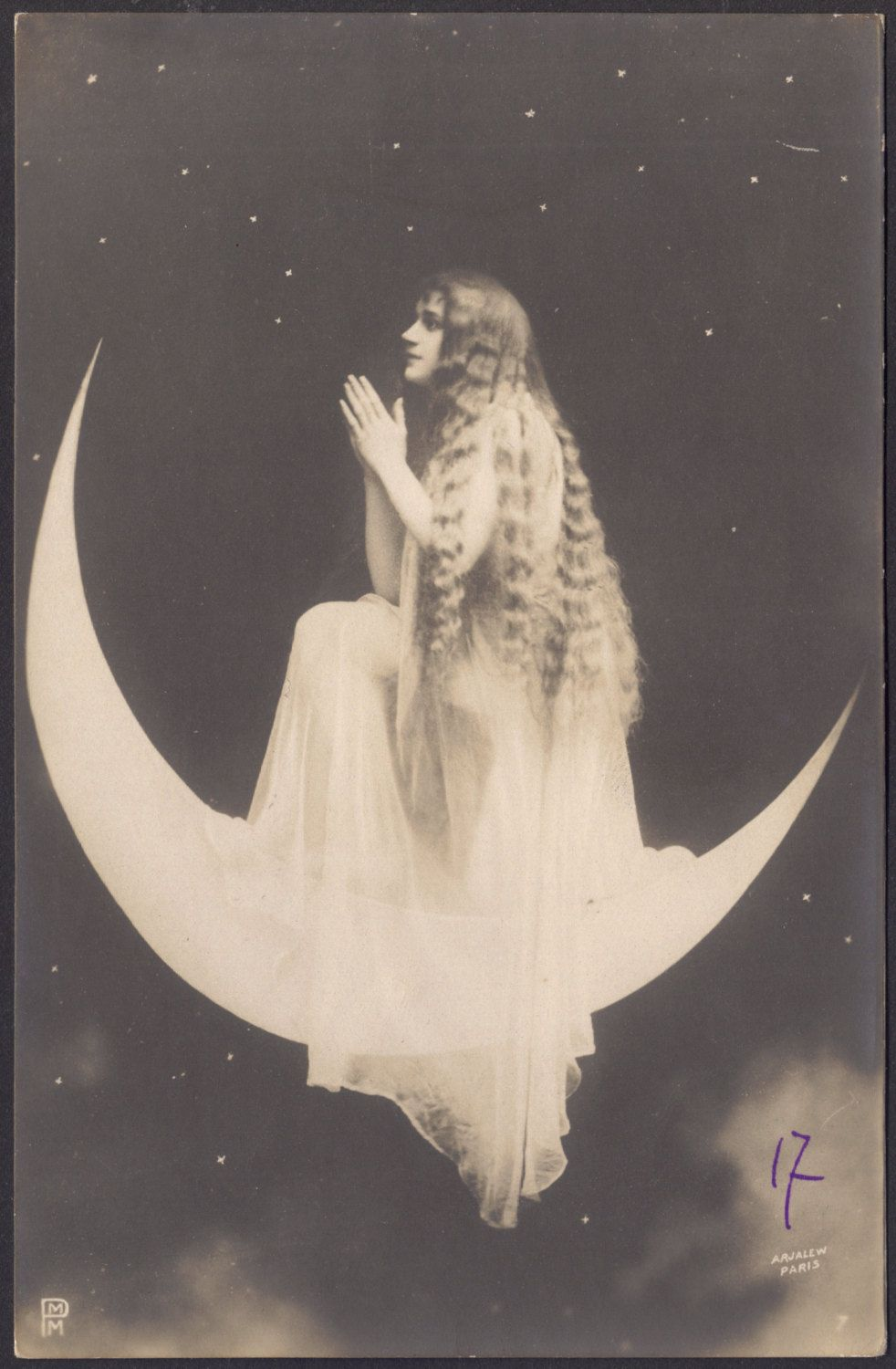 Vintage paper moon with woman praying
