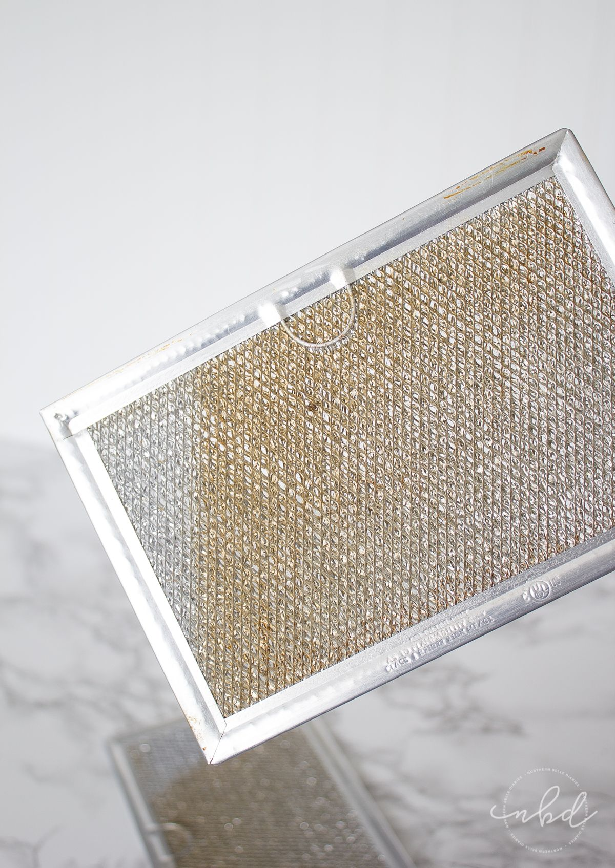 How To Clean A Greasy Range Hood Filter Without Scrubbing Cleaning Hacks House Cleaning Tips Deep Cleaning Tips