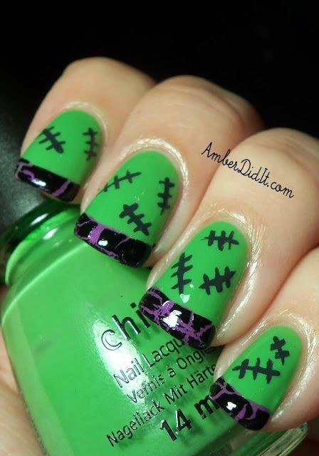 Halloween nail art design in green and purple