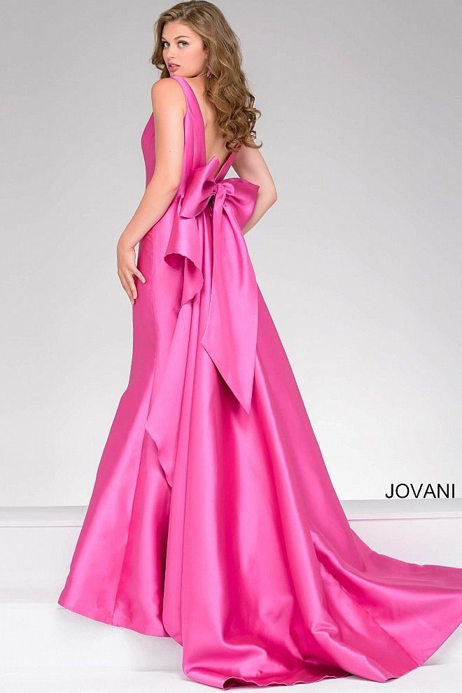 Jovani yellow dress bows on top shoulders.