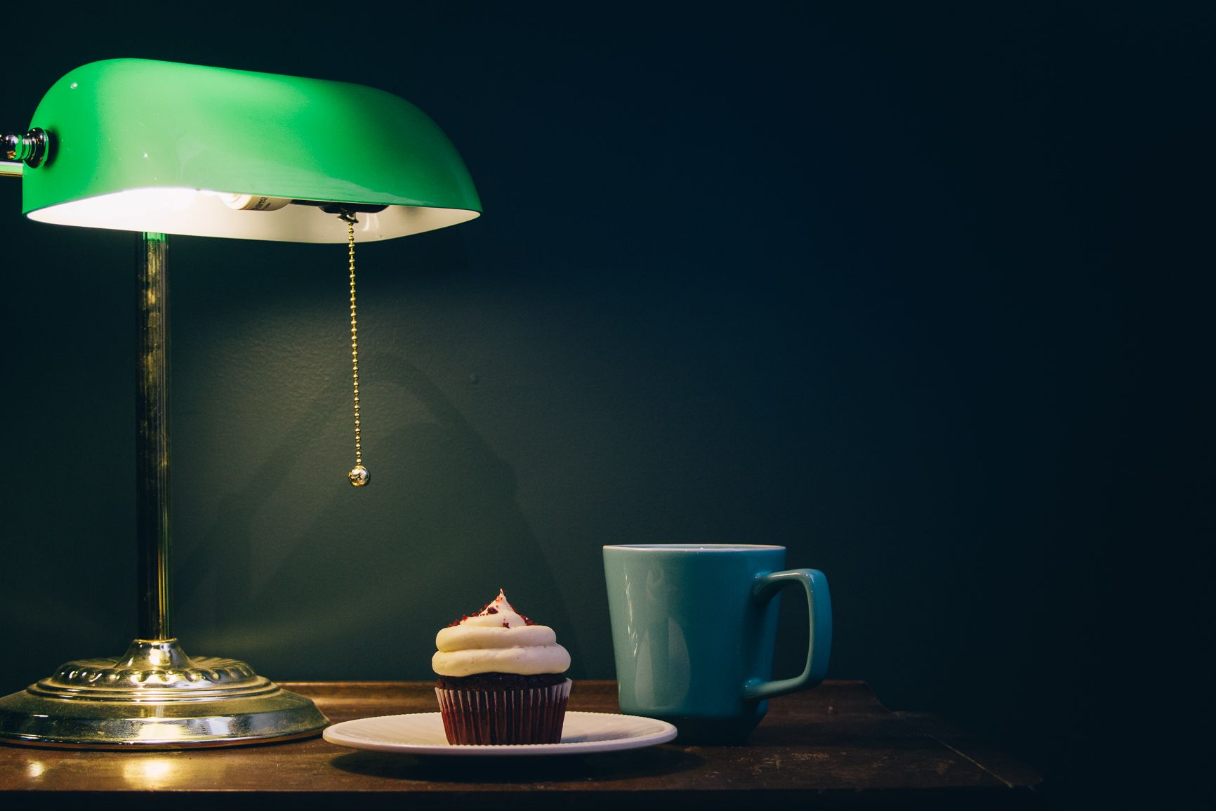 Red Velvet with Cream Cheese Frosting, a cup of coffee, and a quiet corner. Photo by Justin Fennert Photography.