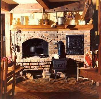 want this fireplace in my kitchen! this arched fireplace holds a