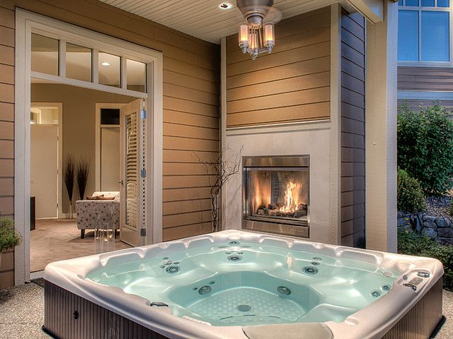 Outdoor Jacuzzi with fireplace built into wall!! Gorgeous home