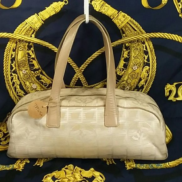 cfd8c6e5d16c1c Authentic Chanel Travel Line Beige Canvas Satchel The bag is in a good  preowned condition with