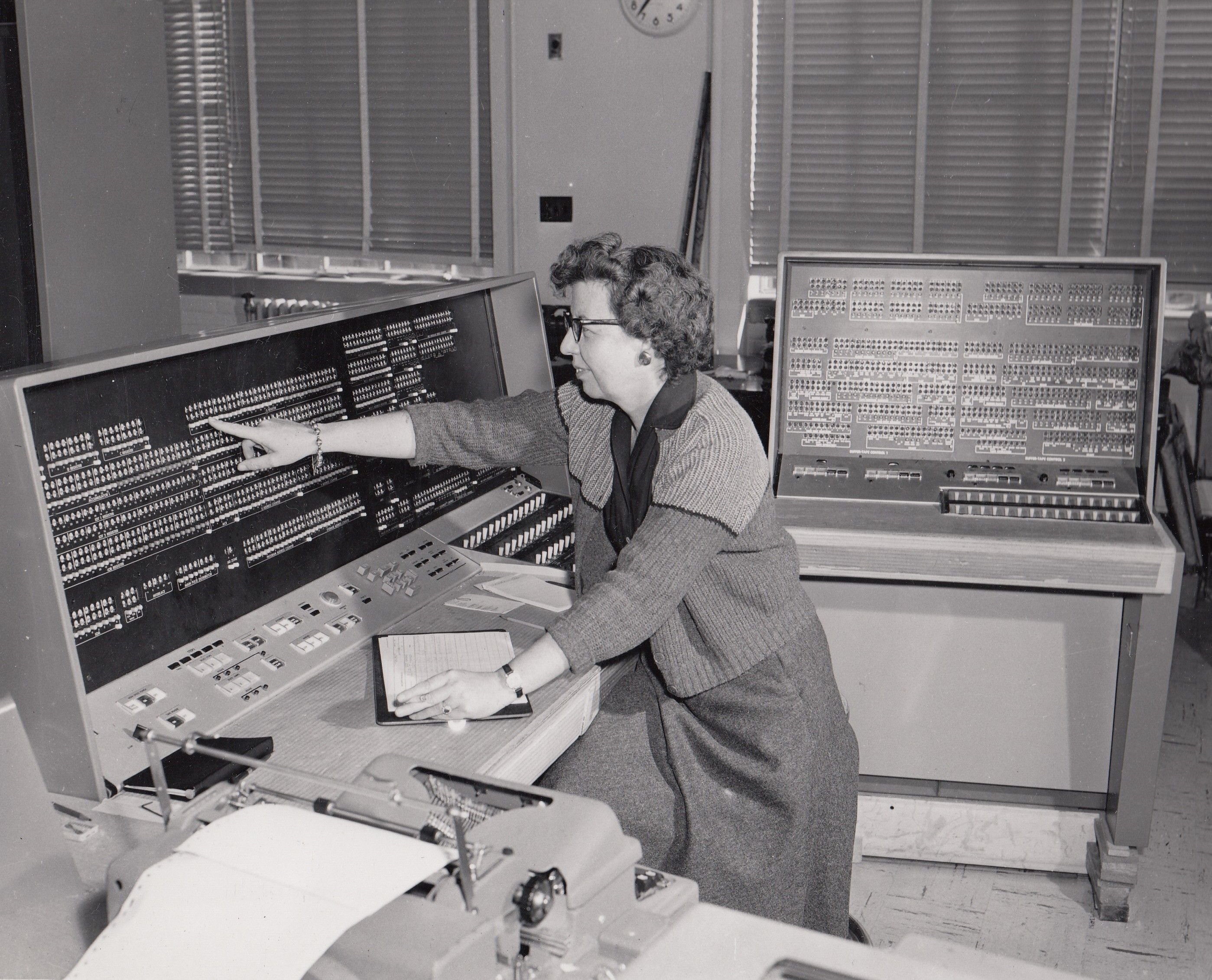 A U.S. Census Bureau employee uses a UNIVAC 1105 computer to tabulate data…