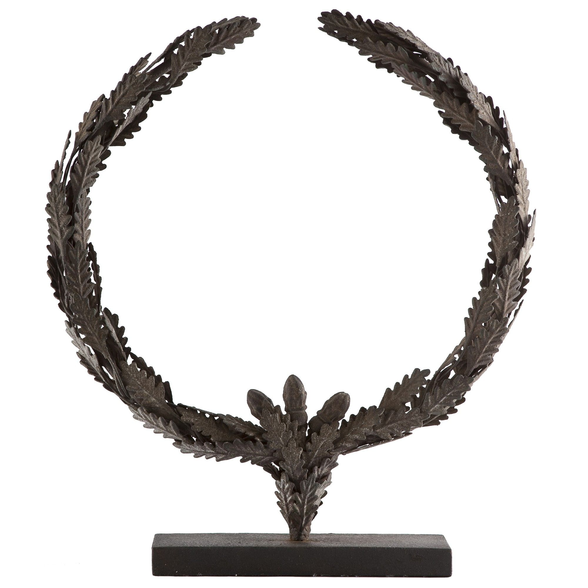 Iron leaves climb up into a crown shape to add texture and drama to any tabletop.