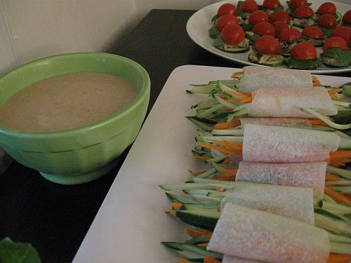 Jicama rolls stuffed with cucumber and carrot and served with an Asian dressing.  Recipe not available.