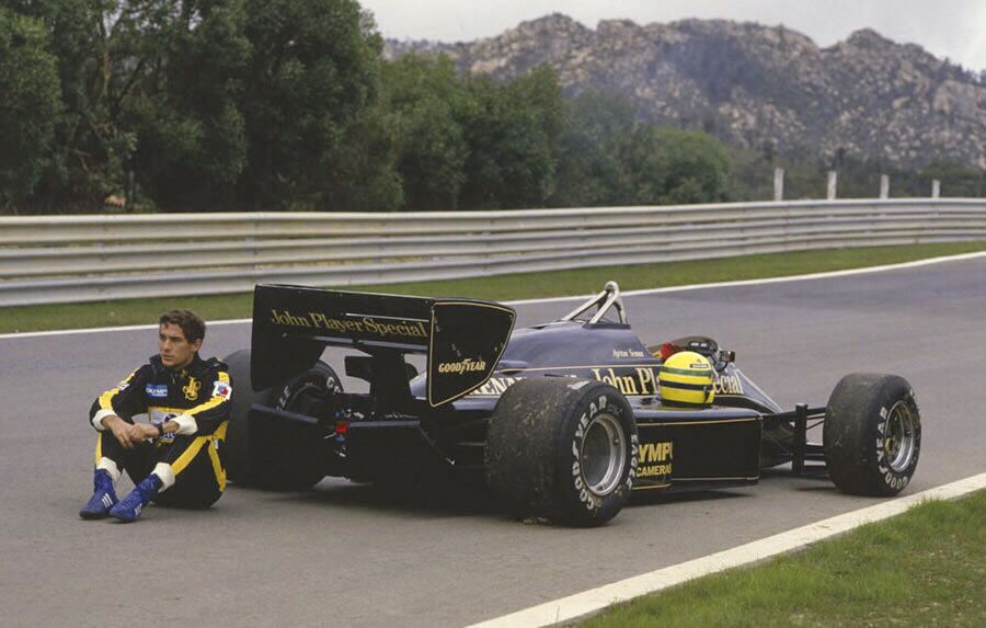 The late great Ayrton Senna next to one of the most iconic F1 cars.